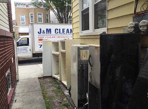 Removing Unwanted appliances from driveway in New York City (before)